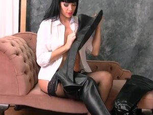 Hot busty babe puts on her thigh high leather