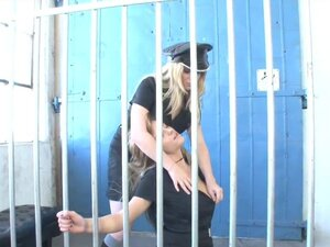 Busty prison guard has lick session with hot