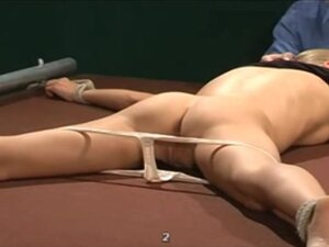 Prison whipping after her panties are pulled down,