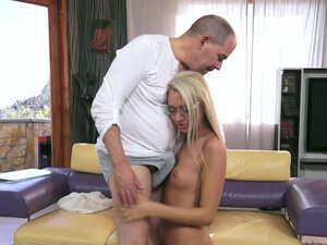 Sexy blonde wearing glasses jumps on top of a guy