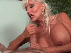 Fine huge titted mature lady stroking cock