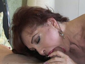 Horny milf Sexy Vanessa gives footjob and blows