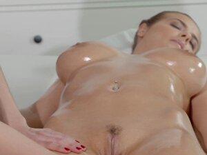 Busty brunette fingers her masseuse