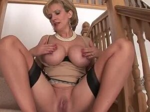Sweet mature slut spreads her pussy on the stairs