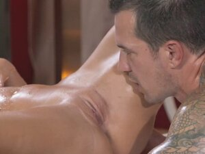 Blonde masseuse rubbing tattooed guy
