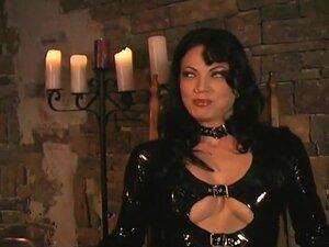 Mistress Jean Enjoys Latex Clad Subs, Mistress