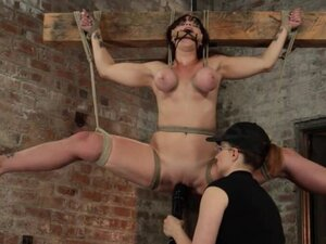 Hung by cross redhead gets toyed