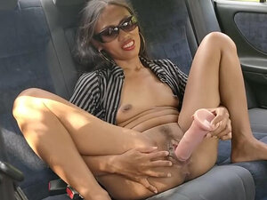 Playing with dildo in the car