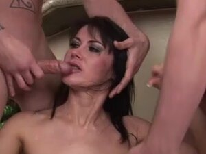 Busty milf at the center of a blowbang