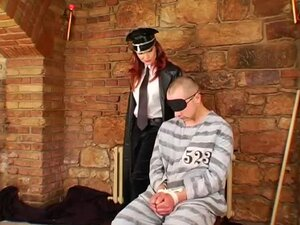 Leather military mistress dominates him