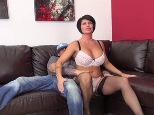 Milf slut with a pair of big fake tits and a hot