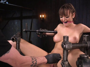 Babe fucked with dildo in device bondage