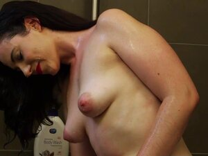 Hairy amateur brunette showering and toying
