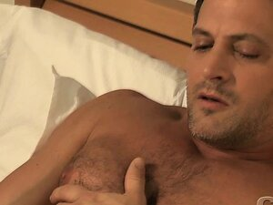 Very handsome man jerking off his cock while