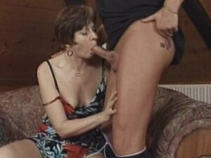 Brunette granny with short hair gets nailed doggy