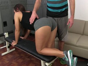 Her trainer helps her stretch then works up a