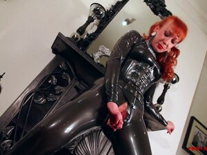 Red lubes up her latex catsuit and rubs her juicy