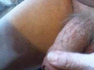 Mature guy playing with his uncut cock