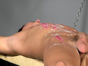 Adam Watson pours Paul Addison's abs with wax